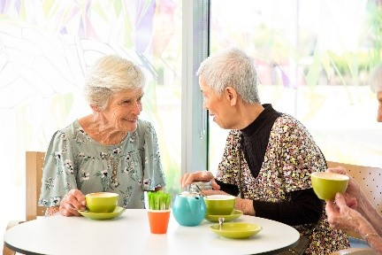 A volunteer works with a CraigCare resident